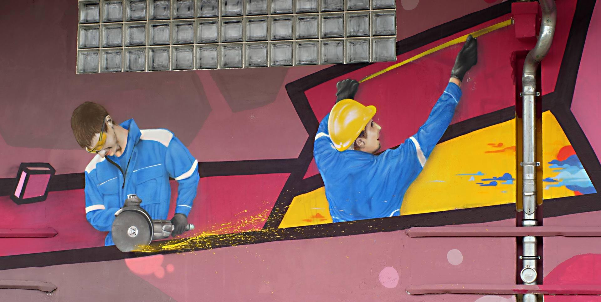 Graffiti vonn zwei arbeitern mit flex